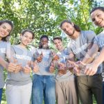 stock-photo-64214909-several-volunteers-with-their-thumbs-up-in-park